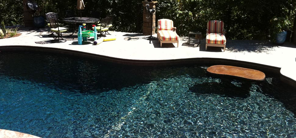 Beadcrete with black sea finish for Pebble finishes for swimming pools